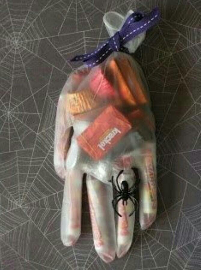 Love this idea vs the decorative bag I fill and give out each year - decorate halloween bags