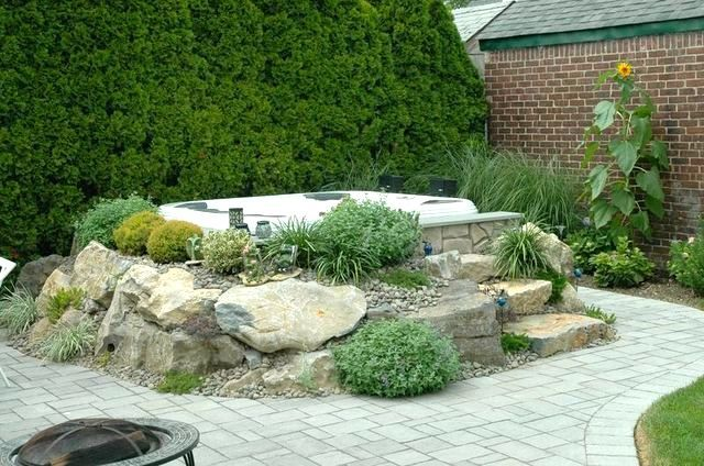 Above ground jacuzzi swim spa with rocks and waterfall for Above ground pool waterfall ideas