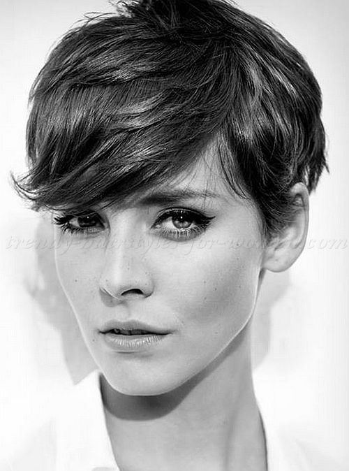 pixie cuts 2014 - side swept bangs, hair by ears moves away from face