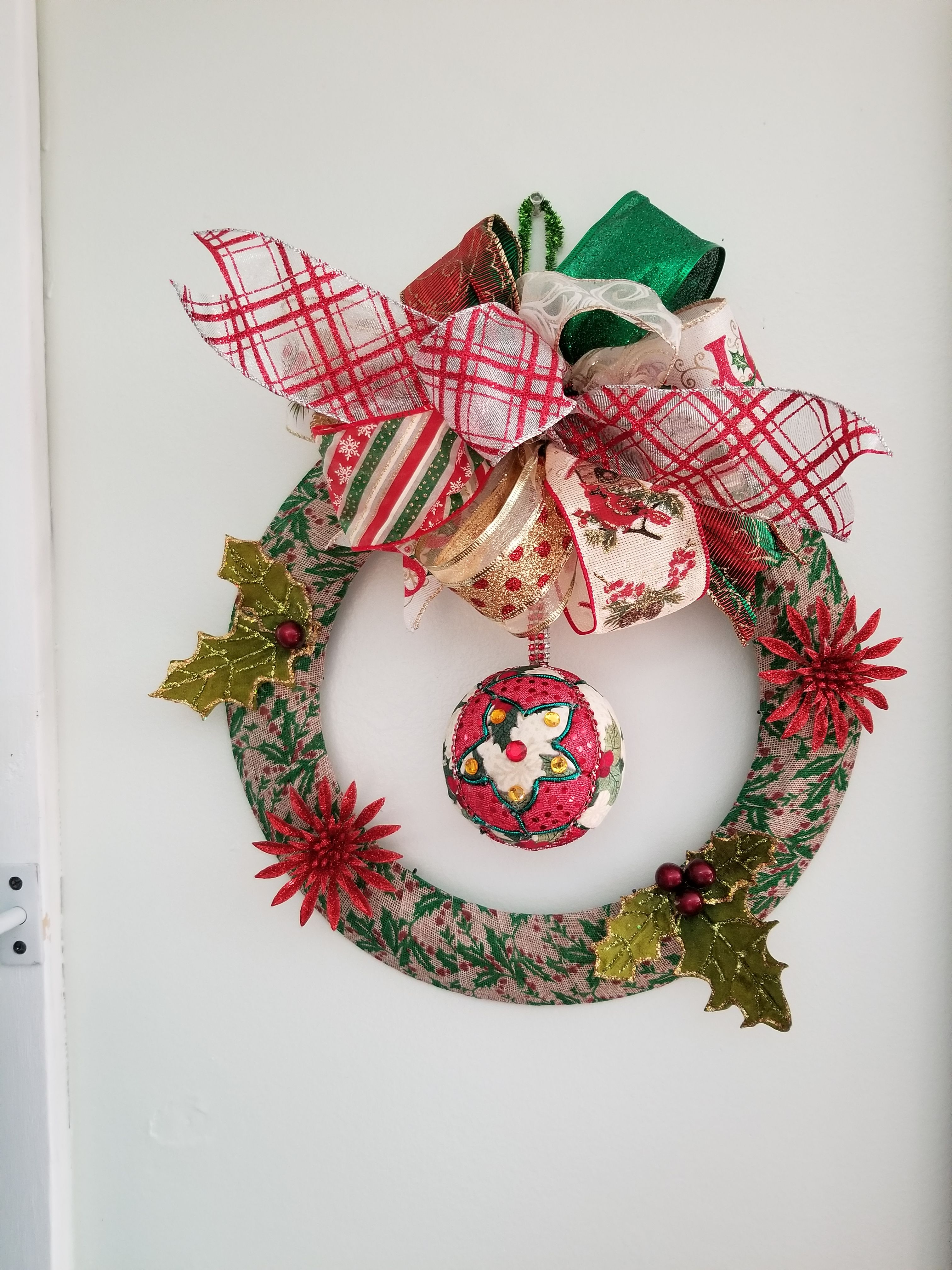 Ribbon Wrapped Wire Frame Wreath With Hand Carved Christmas Ball