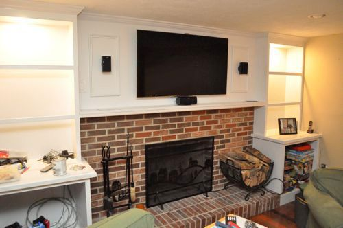 DIY Built ins and fireplace-I love the molding around the speakers ...