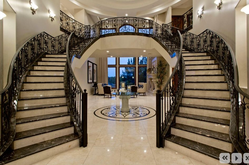 Traditional staircase with double staircase balcony high for Double curved staircase
