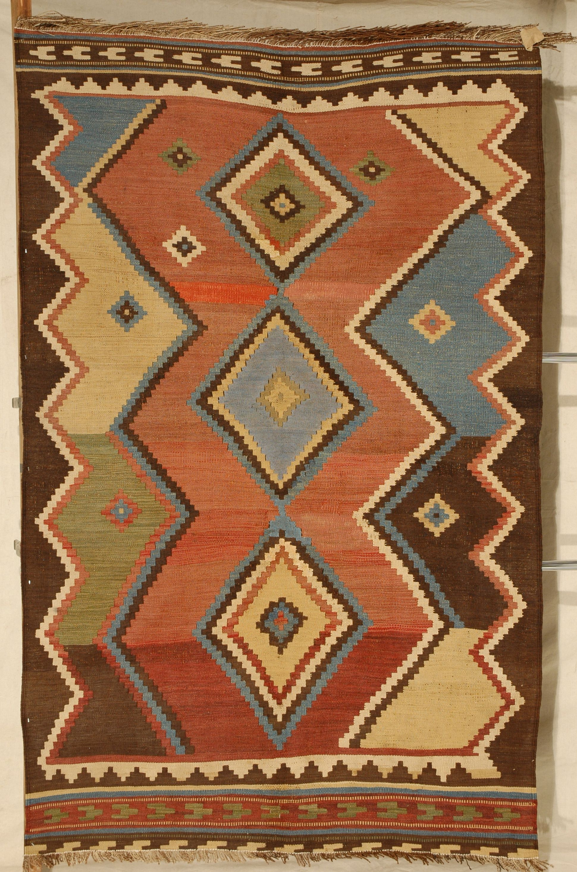 Unusual Blend Of Colors For Such An Old Weaving Rug