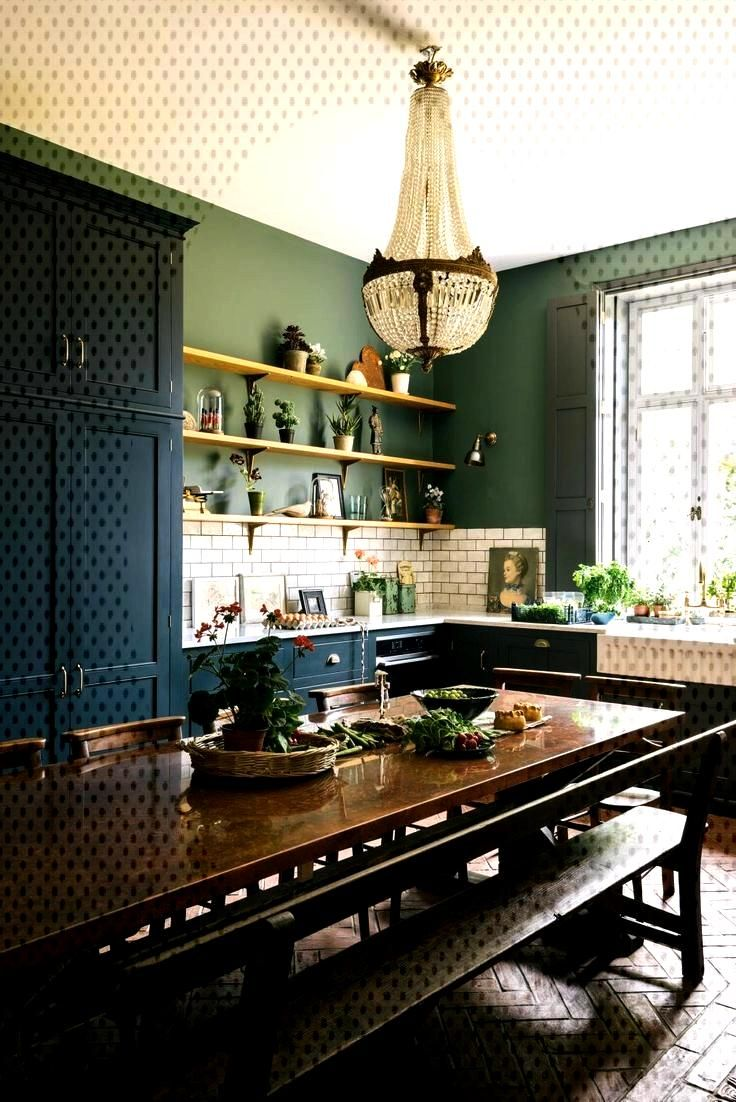 Classic blue kitchen in a Victorian rectory with terracotta floor and green walls with,