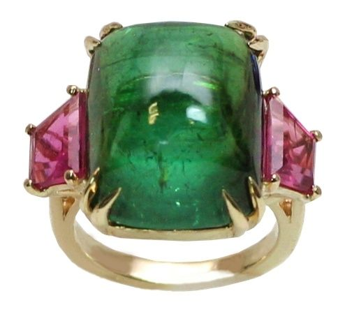This gorgeous ring is crafted by OKGs exclusive designer and master diamond setter Gary Azatyan in 14kt yellow gold and contains 20.00ct Cabochon cut Natural Green Tourmaline and 2 beautiful natural pink tourmalines 1.00ct tw that are cut in a trapezoid shape, set in eagle claw prong setting which is an everlasting style. fOKG Jewelry - Little Neck Jewelry Services - Bayside New York Jewelry - Custom Design Jewelers green and pink tourmaline ring