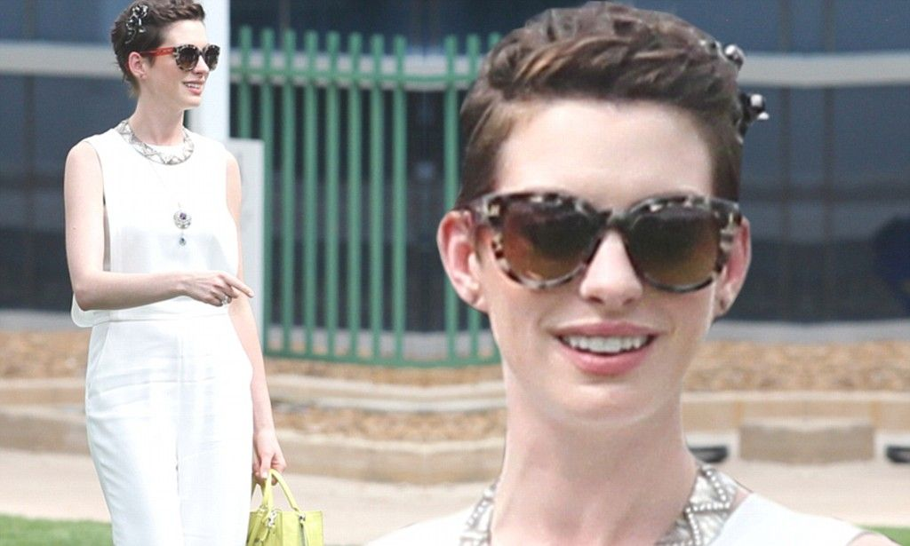 Anne Hathaway oozes glamour in white pantsuit while promoting Rio 2