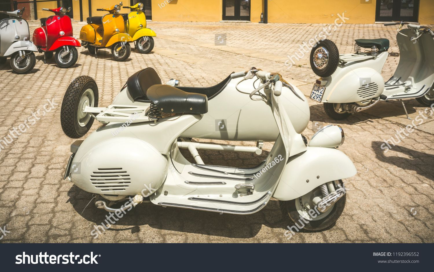 Cagliari Italy April 29 2018 Piaggio Stock Photo (Edit Now) 1192396552 #piaggiovespa Cagliari, Italy - April 29, 2018: Piaggio Vespa vintage scooters meeting. Vintage Vespa with Sidecar from the 50s. Post process in vintage style. #Sponsored , #sponsored, #Piaggio#vintage#Vespa#Italy #piaggiovespa