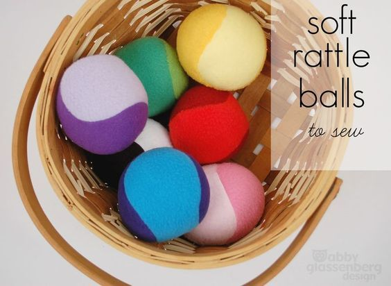 I love these soft sew-it-yourself balls. She puts a rattle insert inside, but I'm sure I could come up with a cheaper alternative that would still rattle :-)