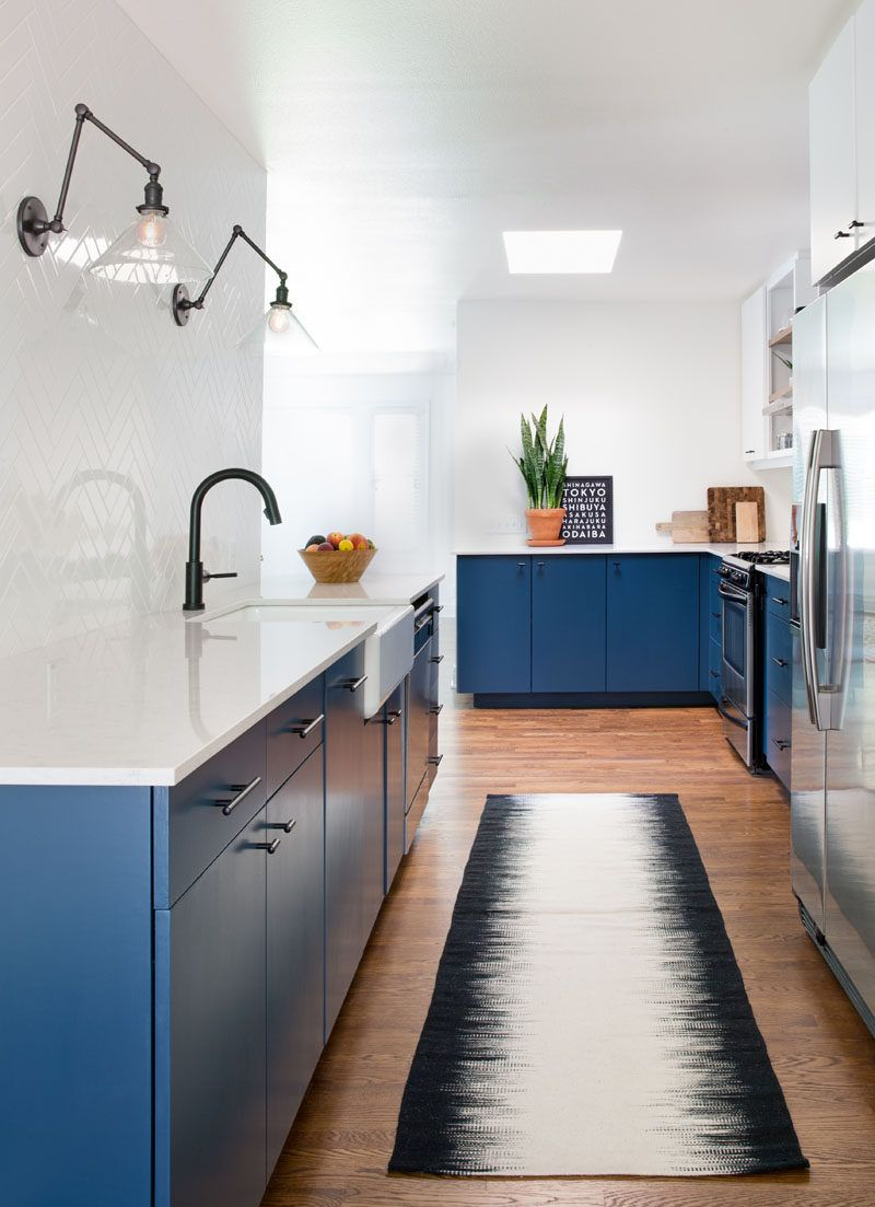 This Home Received An Updated Kitchen With Blue Cabinets And White ...