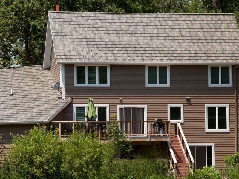 This Multi Colored Brown Roof Is Arrowline S Enhanced Shake T Tone Blend In S6 Canyon A Steelroof With The Beau Metal Roof Houses Siding Styles Steel Siding