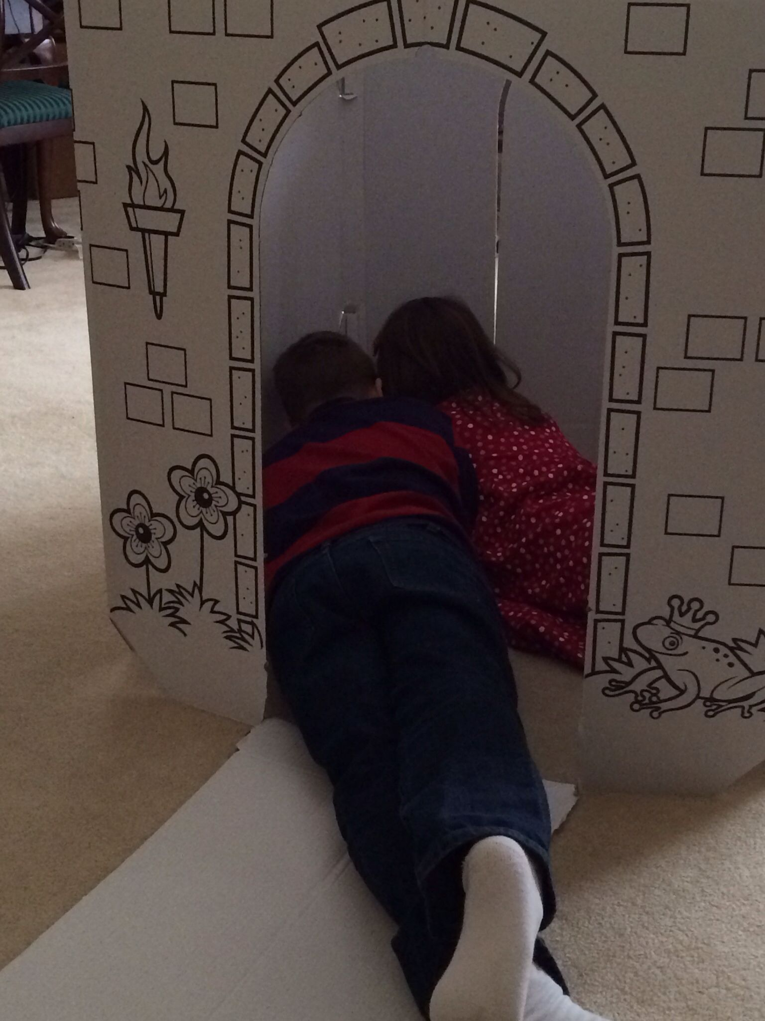 Reading together in a cardboard castle? I love homeschooling.