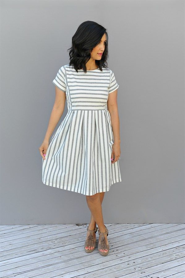 cee7a27d96c2 Our Chambray Stripe pleated Dress are oh so stylish. Pockets, knee length  and has a side zipper for easy fitting.