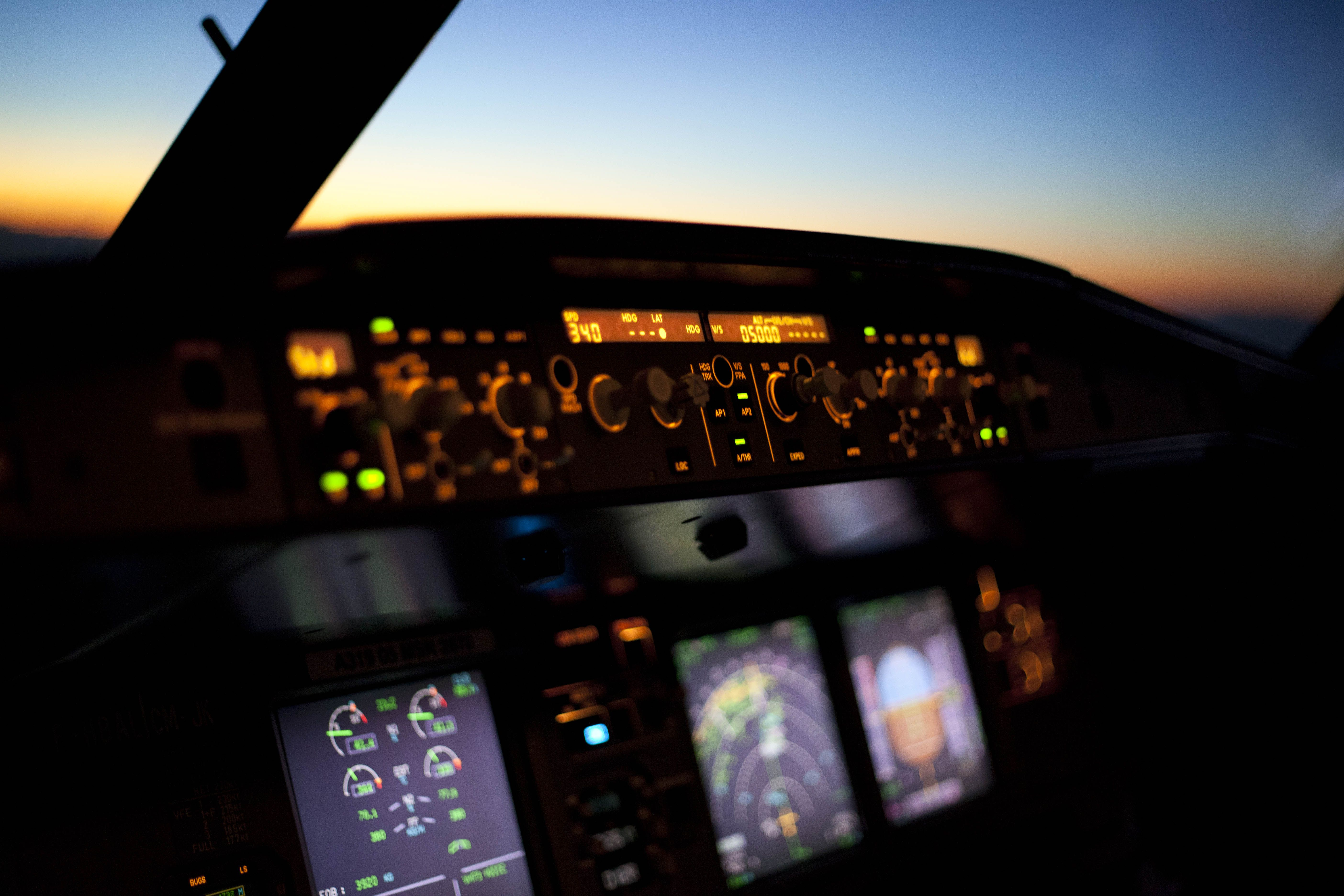 Airbus A320 Cockpit At Sunset