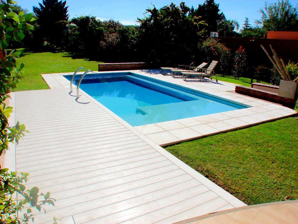 Piscinas familiares piletas de estilo por piscinas scualo for Fotos de disenos de piletas de natacion