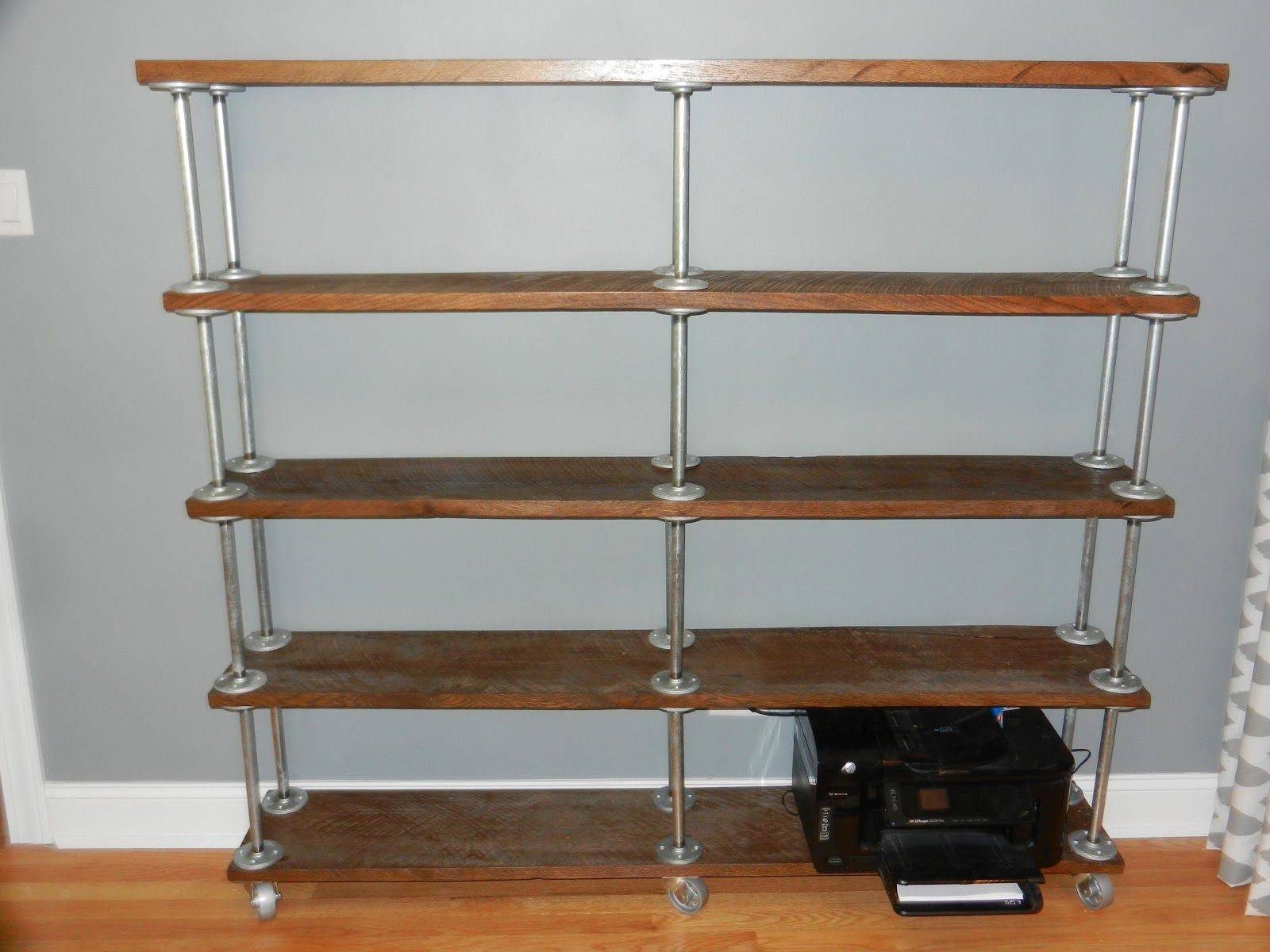 Galvanized pipe bookcase google search condo for Diy industrial bookshelf