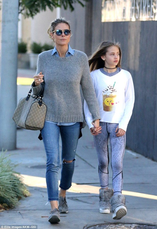adb25499c26e1 Heidi Klum held hands with her daughter Leni as they went shopping in West  Ho.