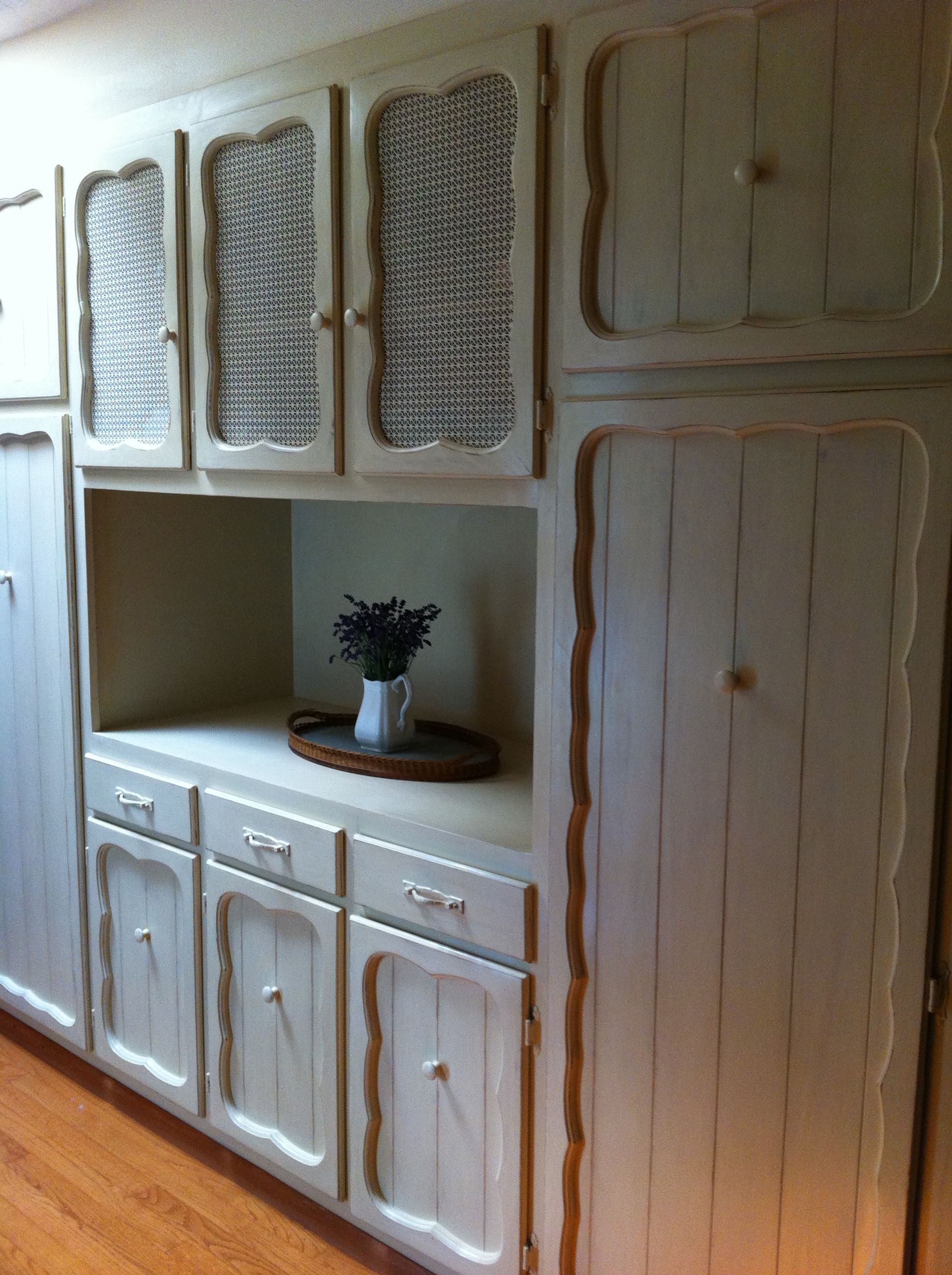 Cabinets AFTER in our entryway painted and distressed with