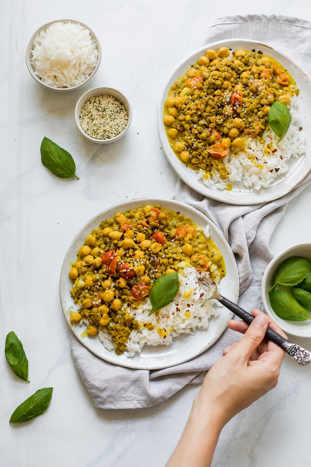 The BEST Coconut Lentil & Chickpea Curry The BEST Coconut Lentil & Chickpea Curry that's creamy, sweet, savory, spicy, and pairs perfectly with rice. Top it off with basil for the perfect, easy, healthy dinner recipe! This recipe is vegan, vegetarian, gluten-free, and dairy-free.