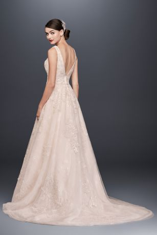 Crafted of tulle over lace for added dimension, this Oleg Cassini A ...