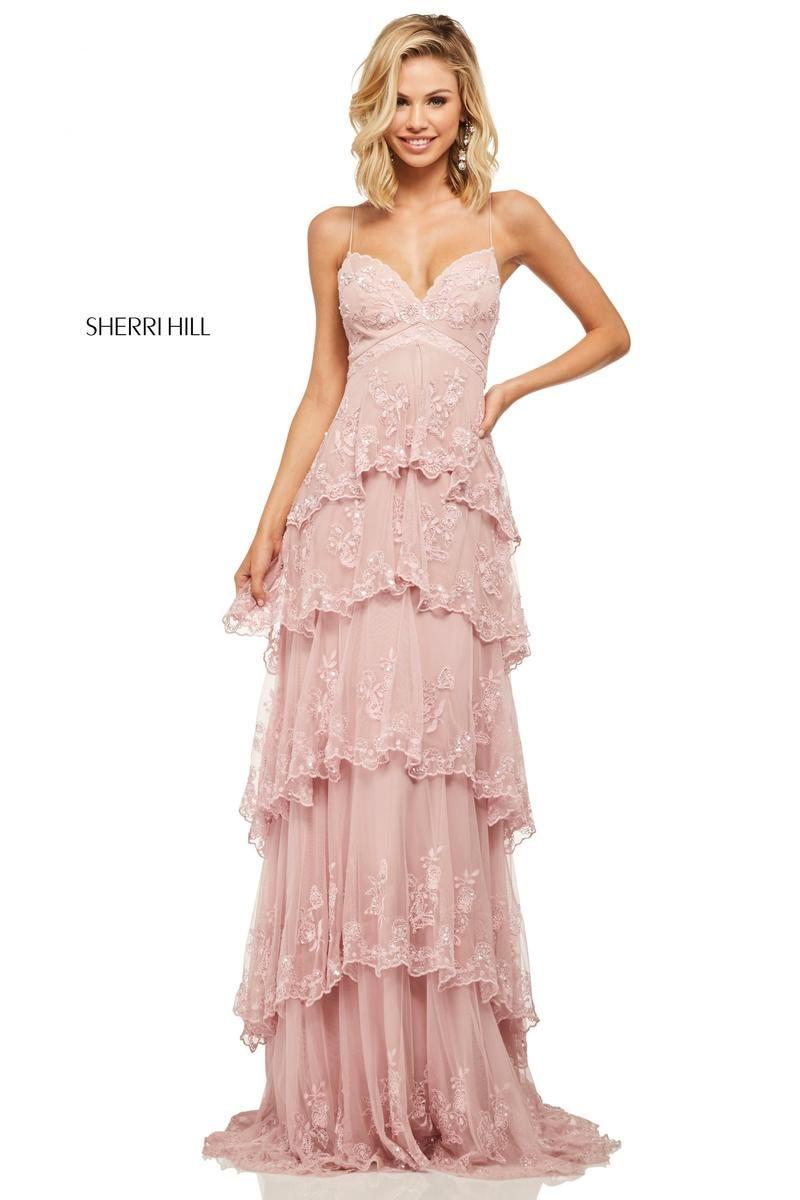 6d2ac95d672 Sherri Hill 52806 is a beautiful dusty rose colored prom dress in a  beautiful boho style! www.bravurafashion.com Bravura Fashion is located in  Marietta