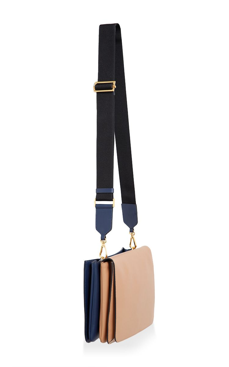 This shoulder bag by **Marni** is rendered in calf leather and features rose tinted hardware and multiple compartments.