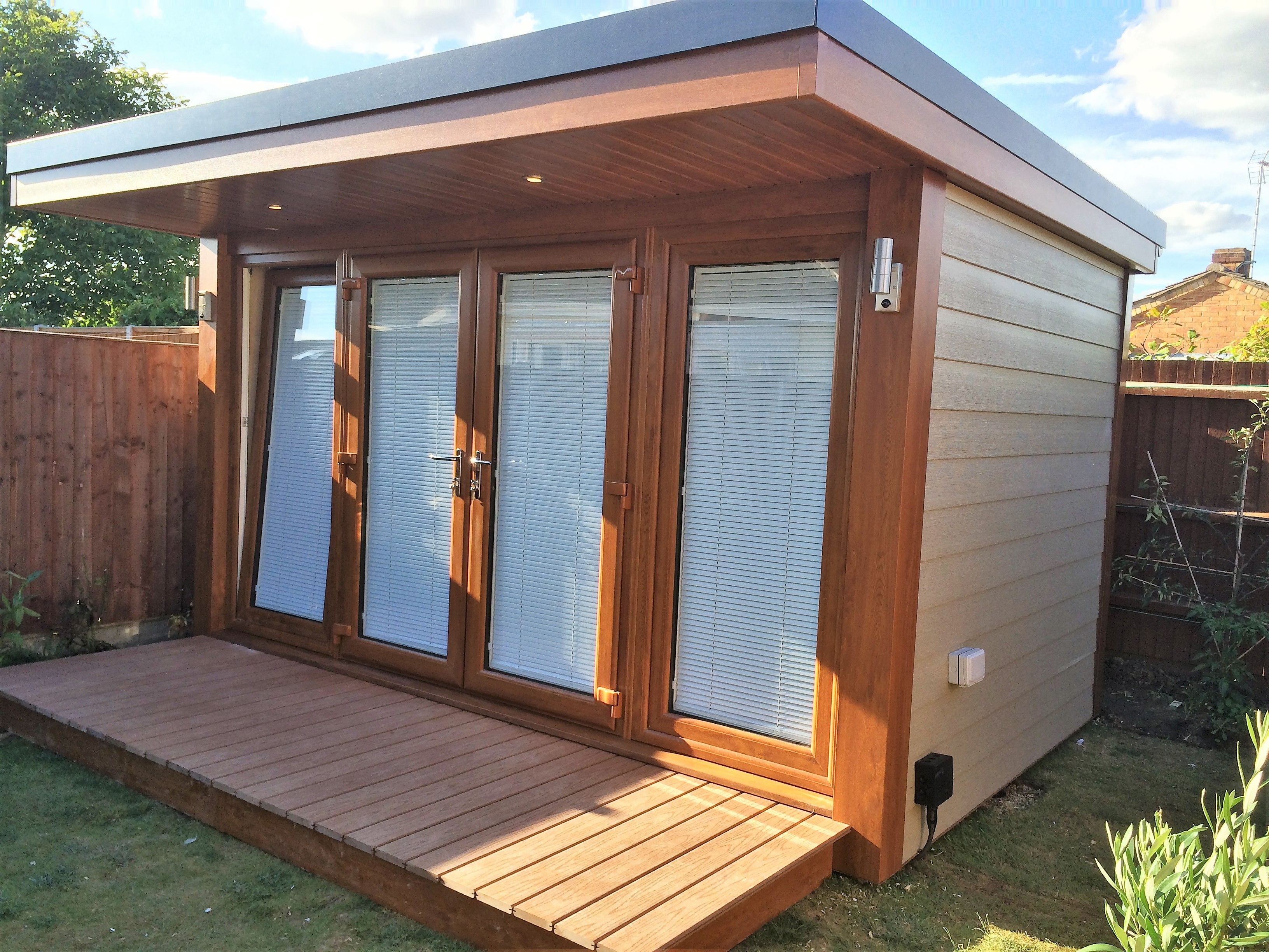 Oak and embossed cedar garden office with flyover roof and for Cedar garden office