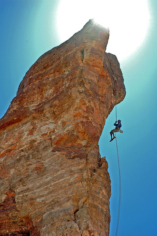 Layton Kor rappels of Kor's Kastle in western Arizona after its first ascent in April 2009. Photograph by Stewart M. Green.