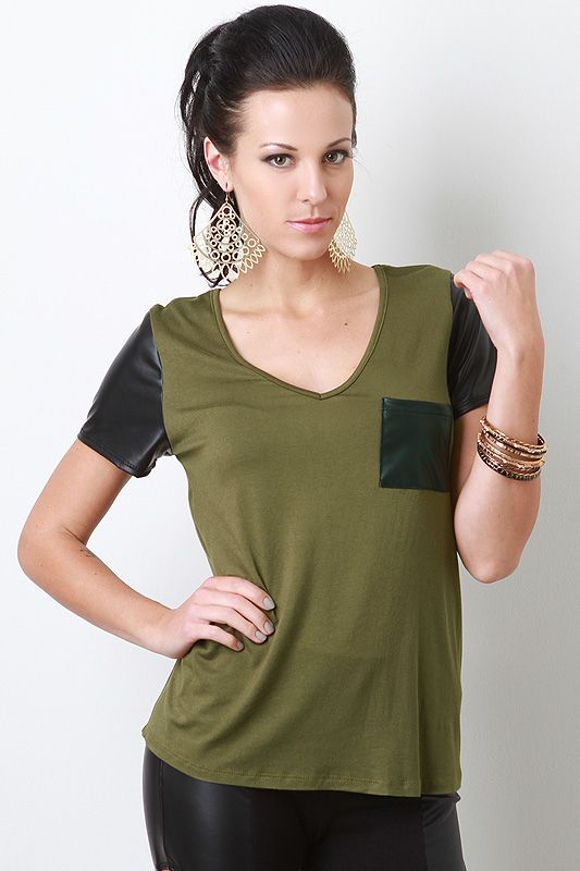 Stay comfy and stylish in this Mod Amusement Top! This top features soft jersey knit, leatherette breast pocket, deep v neckline, short leatherette sleeves, and finished with stitching detail
