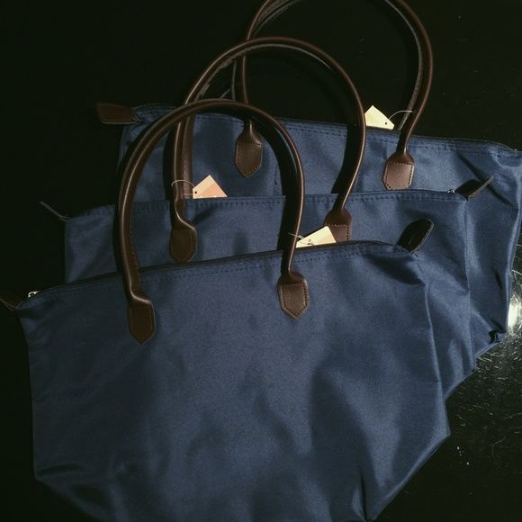(2) Navy Longchamp Dupe Tote Bag DUPE, a little smaller than the real one! Really cute and goes with anything. Has brown handles! Holds a lot for when you're going out. Very close to the real thing! PRICE OF ONE, BUY BOTH FOR $20! BUNDLE TO SAVE Bags Totes