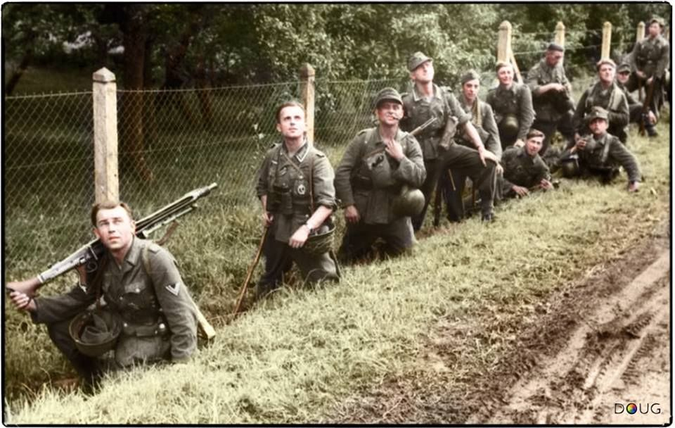 """German infantrymen scan the skies for Allied aircraft in Normandy, (after the invasion) June 1944.  During the day, German troops caught in the open were easy prey for Allied aircraft , the """"Jabos"""" would get them. (From the German """"Jagdbomber"""" or """"hunter-bomber.""""  (Source - Bundesarchiv, Bild 101I-731-0388-20 / Theobald / CC-BY-SA)  (Colourised by Doug)"""