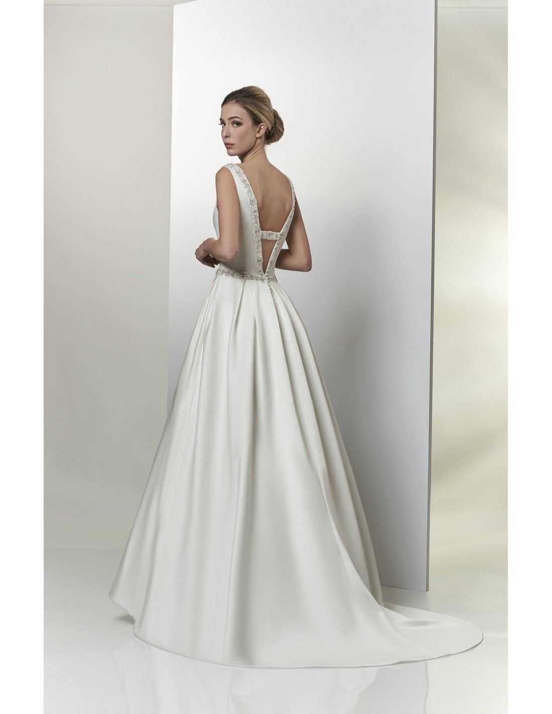 Satin ballgown with detailed back available at Spotlight Formal Wear! #SpotlightBridal