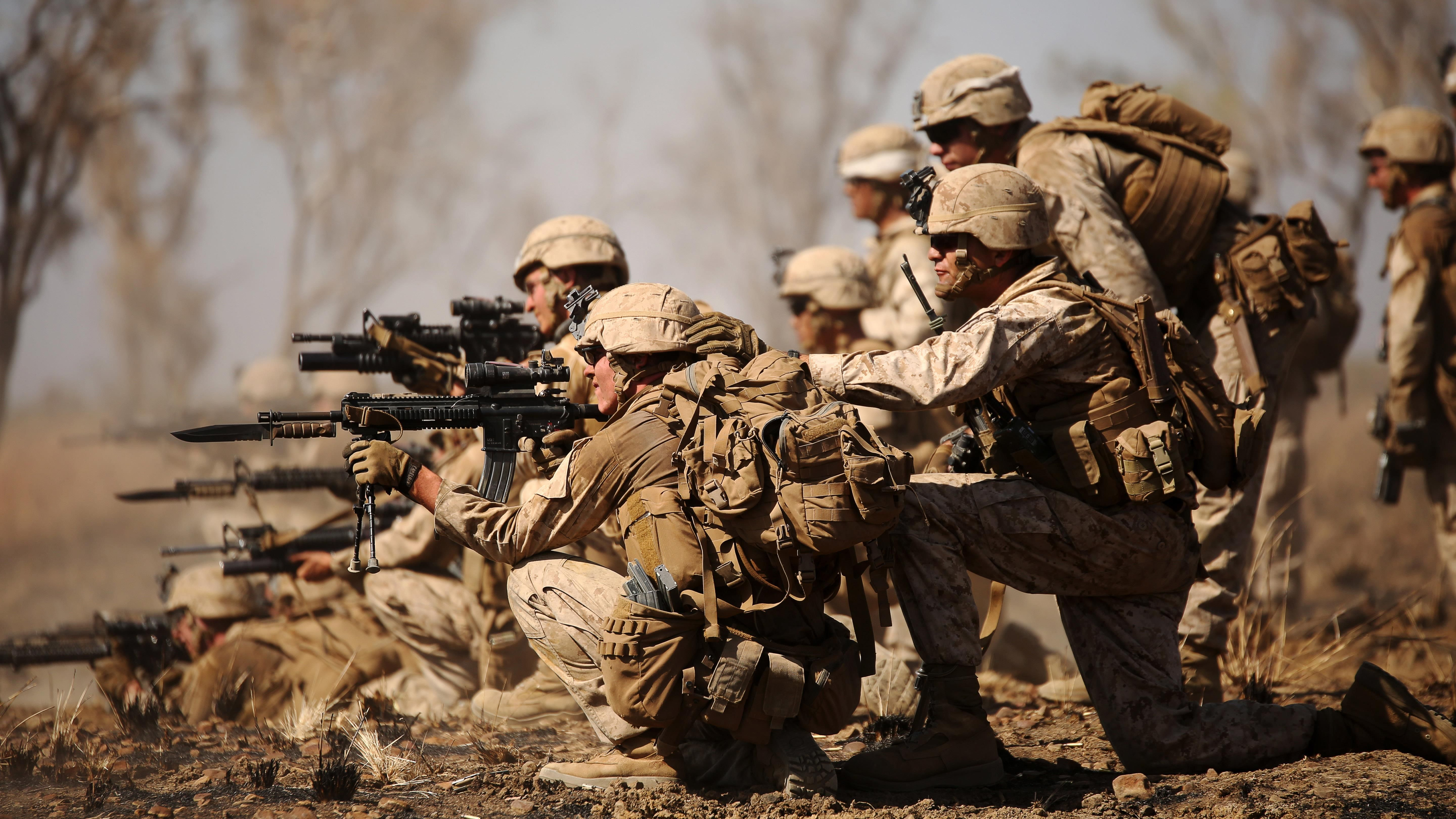 Marines with Company B, 1st Battalion, 1st Marine Regiment, attack an objective during a live-fire range movement at Bradshaw Field Training Area, Northern Territory, Australia, August 10, 2016