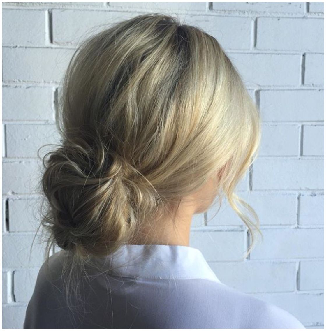 Back View Of Low Loose Bun Short Hair Bun Low Bun Hairstyles Messy Hairstyles