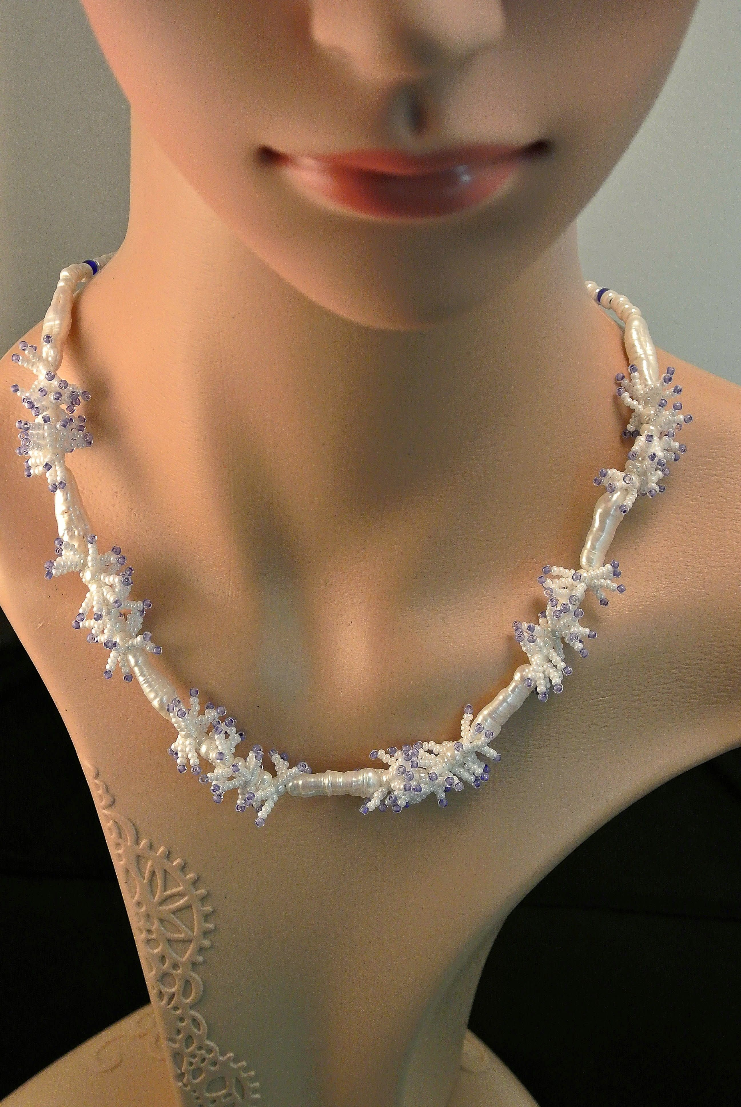 Necklace made from fresh water pearls separated by clusters of pale purple and white Japanese beads