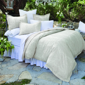 I like the duvet.  Maybe put a silk/linen bed skirt and accent pillows.  Do a little tone on tone thing.