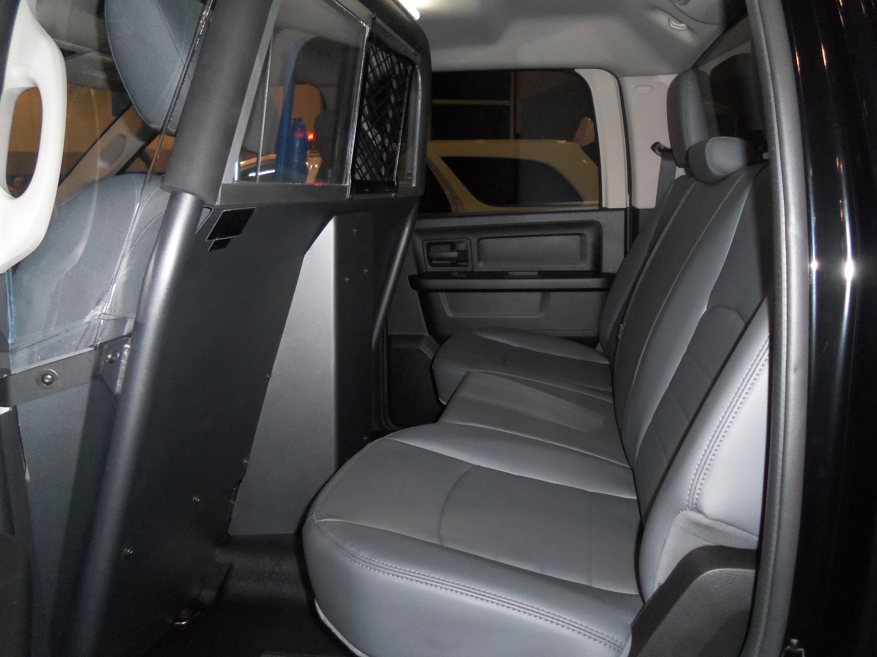 rear seat view with prisoner partition the dodge ram 1500 special service vehicle displayed in. Black Bedroom Furniture Sets. Home Design Ideas