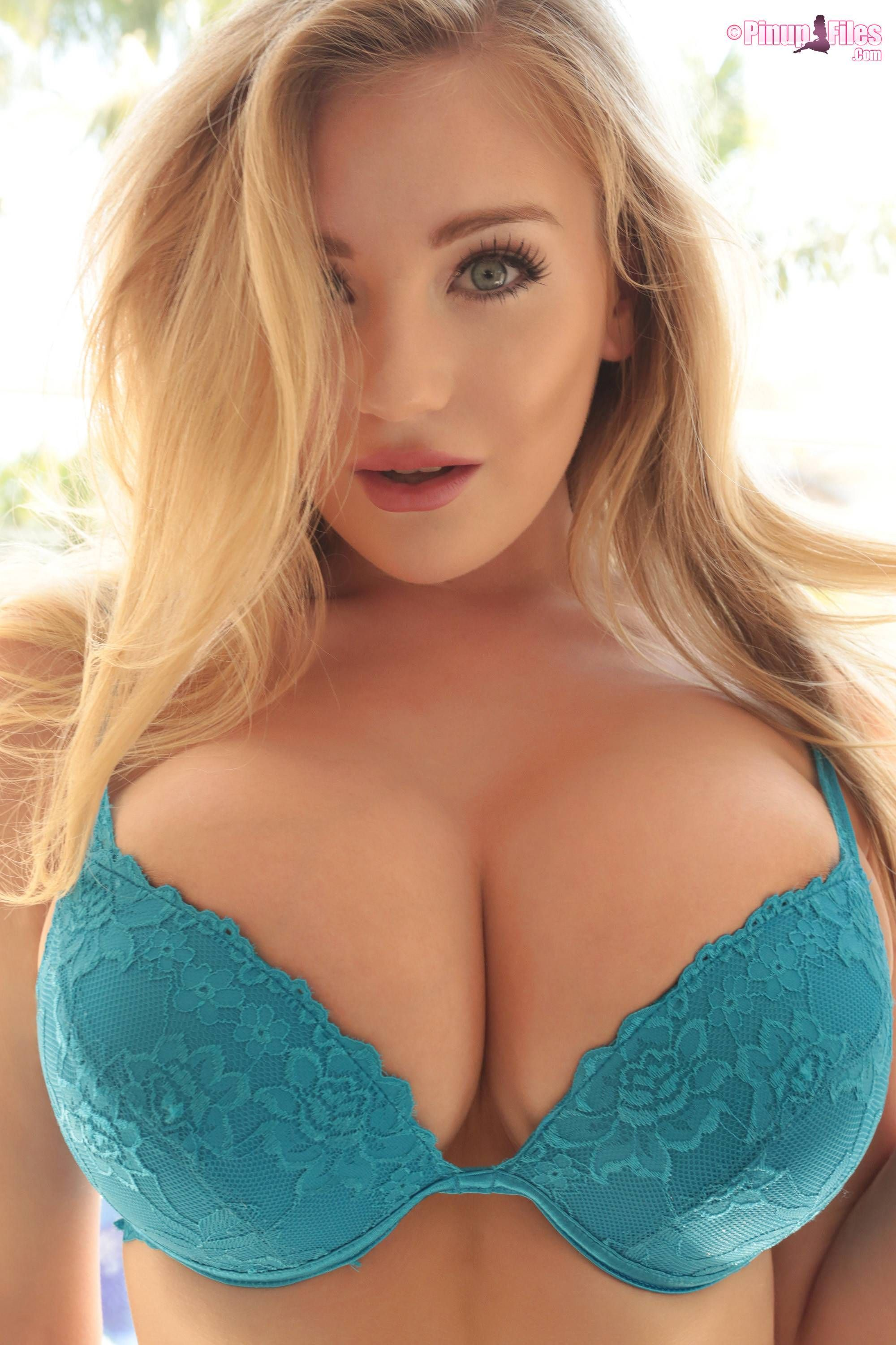 Gorgeous blonde model Beth Lily in blue bra.