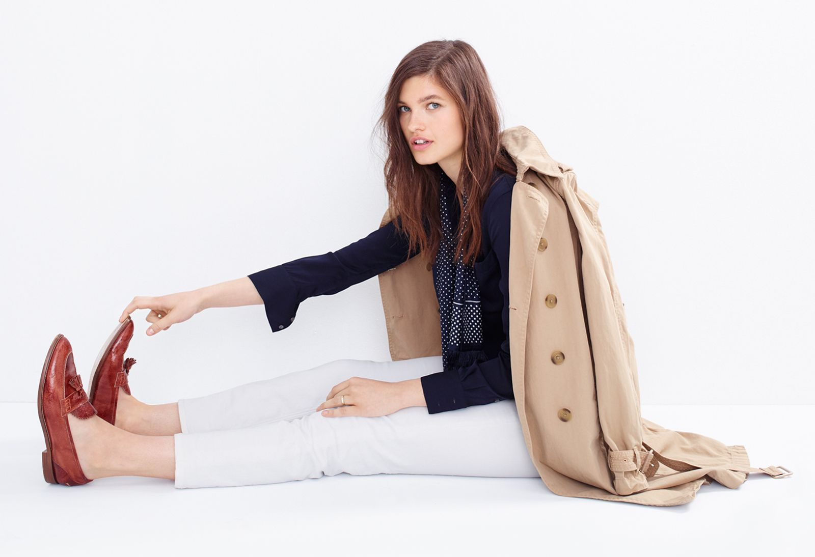 J.Crew Looks We Love: women's washed cotton trench coat, silk pocket blouse, matchstick jean in white, silk scarf in dot and Biella crackled leather loafers.