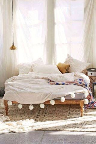 Interior design bedroom, wood bed  white blanket with pon pons