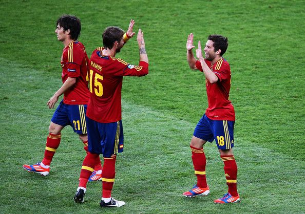 Jordi Alba (R) of Spain celebrates with team-mates Sergio Ramos (C) and David Silva after scoring his team's second goal during the UEFA EURO 2012 final match between Spain and Italy at the Olympic Stadium on July 1, 2012 in Kiev, Ukraine.