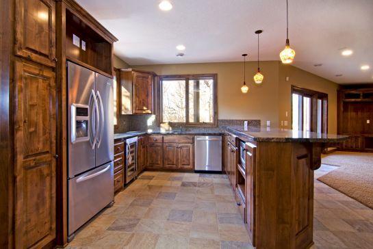 Large, darkly stained custom bar area - Creek Hill Custom Homes MN ...