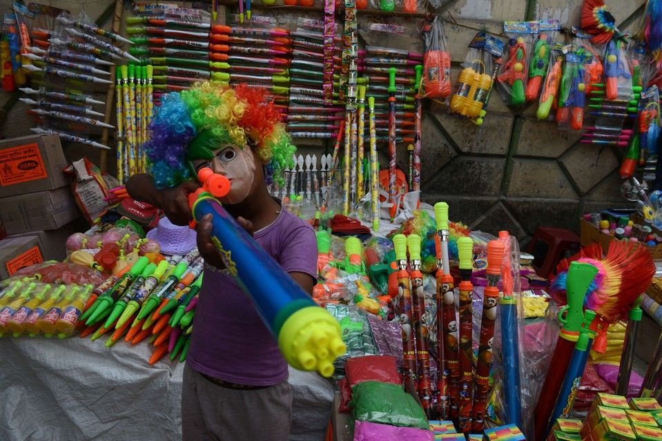 Week of Mar 8-14, 2014 An child posed at a stall selling water guns for the upcoming Hindu festival of Holi in Siliguri on Thursday. (Diptendu Dutta/Agence France-Presse/Getty Images)
