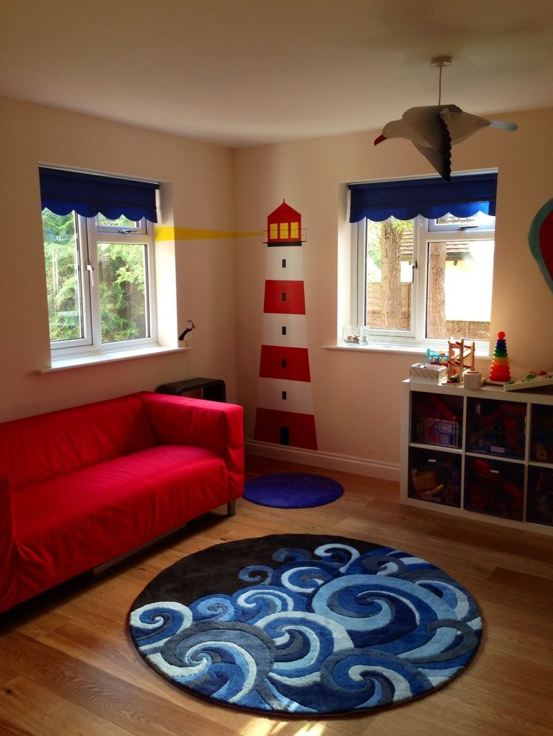Beautiful Furniture Playroom Decor With Carpet And Red Sofa On Wood Floored Room  Considerations While Planning The Playroom Decor