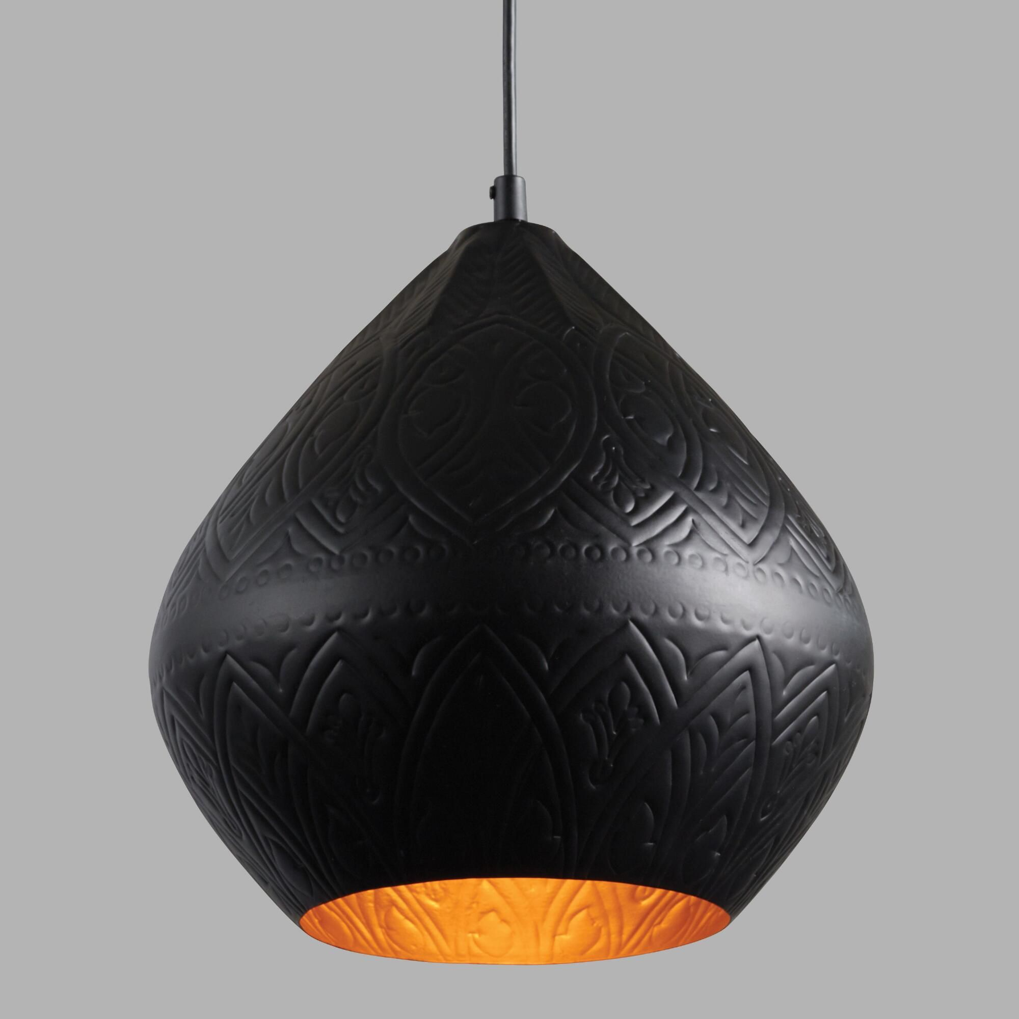Black and Gold Teardrop Sachi Pendant Lamp by World Market is part of Gold Home Accessories Lamps - Pendants And Chandeliers Handcrafted by Indian artisans, our exclusive pendant lamp features a bold teardrop shape with a matte black exterior and a matte gold interior  An intricate design is embossed across its entire surface, drawing the eye with its subtle texture  Material , ColorBlack  Also could be used forhanging lamp,hanging decor,home decor,decor,hanging light,light,lighting,dining room lighting,kitchen lighting,living room lighting,hanging pendant,pendant lamp,pendant light,metal,artisan,subtle design,intricate design  By Cost Plus World Market 549969