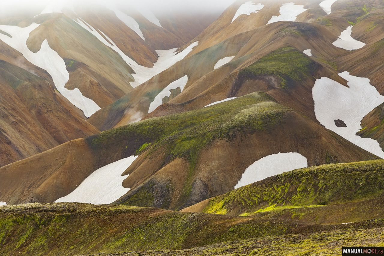 hiking on a trail in the highlands and the fog gradually lifted up in front of us to reveal this beautiful mountain with snow pockets. Too bad it came back down shortly after. Iceland