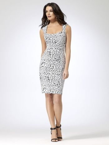 Sleeveless textured jacquard knit dress with black and white animal print.  Square neckline. Open back with double button closure at neck. 25e72bccf