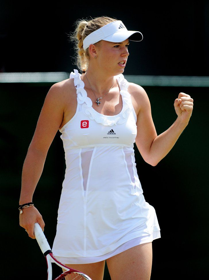 Pin for Later: We've Got Nothing but Love For These Ace Tennis Looks  Caroline Wozniacki again showed off Stella McCartney's dress designs, but this time in white. Which one do you prefer?