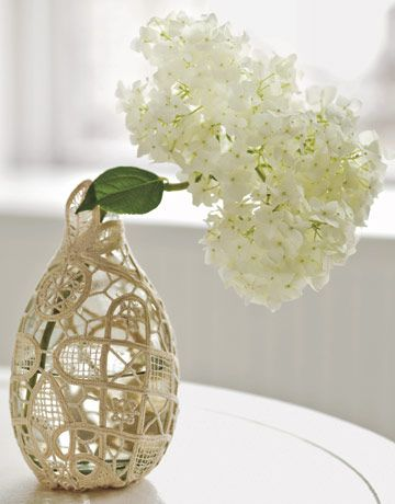 Doily-wrapped vase: Tightly wrap a doily around a vase. Snip away any excess, then hand-stitch the doily to create a snug fit.