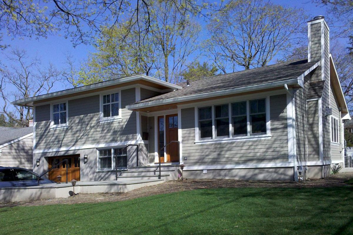 Great split level exterior remodel in ny trim and siding for Redesign house exterior