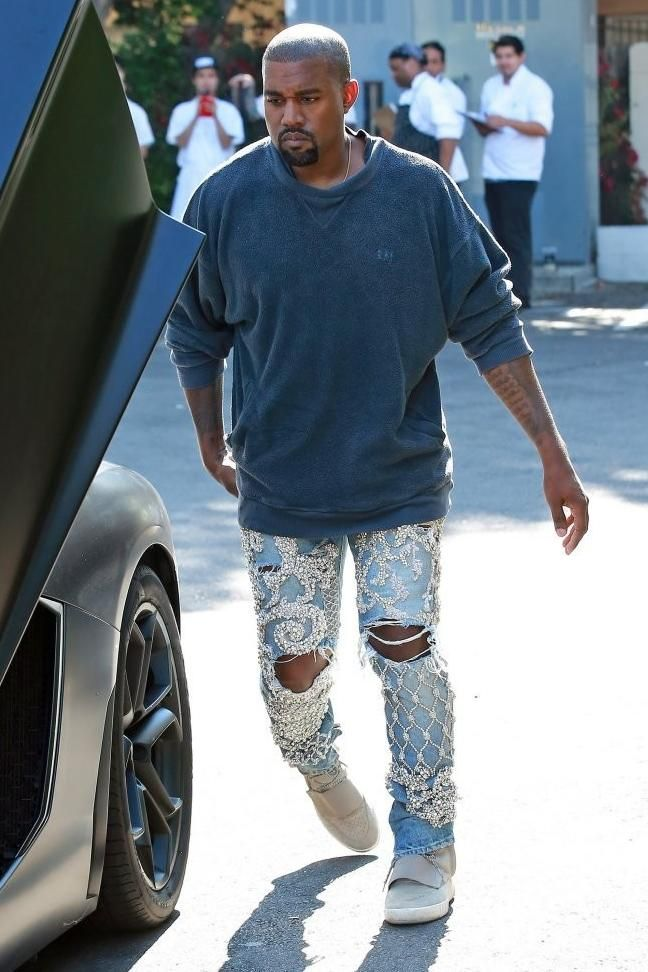 52a3d321 Kanye West wearing Yeezy Boost 750 and Balmain Custom Embellished Jeans